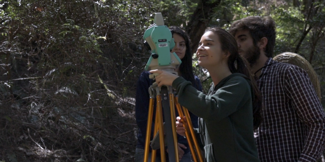 An image of students using a total station