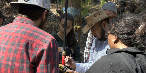 An image of Nick Malloy and Students working with a Trimble GPS